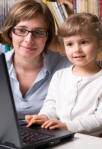 mother and daughter on computer at gateway to family fun sites